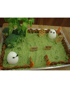This delightfully simple graveyard herb dip was created by ljpurtee, featuring hard-boiled-egg ghosts, cracker gravestones, and broccoli and celery trees.