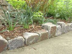 stone garden edging  -- I'd like this around the flowers by the side of the house...