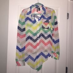 Cute Chevron sheer button down top Super cute top, sheer material so you can pair with a white or bright colored tank underneath. Blue, yellow, navy, green, Black and Tan chevron stripes on white background. Can be worn as long sleeve or roll them and fasten with a button for a 3/4 sleeve. The bottom can be tucked in or even tied. Looks great dressed up or down! new directions Tops Blouses