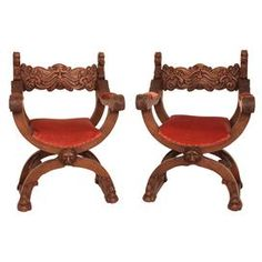 Set of two vintage European Renaissance-style greenman Product: Set of 2 chairsConstruction Material: Mahogany and velvetColor: Brown and roseFeatures:  European renaissance ambassador styleHand-carved details Dimensions: 37.5 H x 17 W x 26.5 D eachNote: Due to the vintage nature of this product, some wear and tear is to be expected. Products may show signs of brand marks, scrapes or other blemishes.