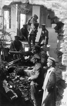 """historywars: """" A Bulgarian Maxim machine gun team ready for action in the ruins of a house in Macedonia, 1917. """""""
