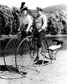 circa 1910- double bicycle with a baby carrier...Nothing to keep the baby from rolling out!