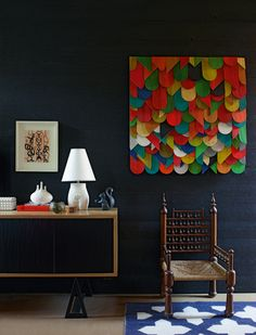 Brightly painted and uniquely shaped wood mounted together as wall decor