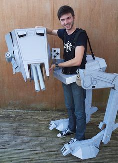 """This is an awesome AT-ST costume, this homemade costume created by Tom Judge for a Star Wars themed dinner party. Made of cardboard.   """"After blowing up a papercraft template from the internet to man sized, Tom then went on to make the needed adjustments so he could get into it with ease. As the video shows movement is fairly easy and there are moving parts and a nice little head hatch. """"  More pics and video after the more."""