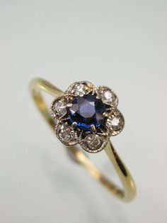 ART DECO DIAMOND & SAPPHIRE FLOWER CLUSTER RING. Like the daintiness of this ring.  The flower is kind of simple though