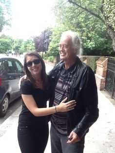 Jimmy Page with a fan outside his home in London, Aug. 12, 2014.