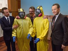 Actors Bryan Cranston, right, and Aaron Paul, left, pose with 'Breaking Bad' show creator Vince Gilligan, center, around the character's hazmat suits. They were donated with other show items to the Smithsonian Museum of American History on Nov. 10, 2015.  Jack Gruber, USA TODAY