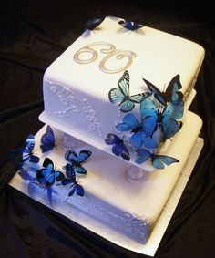 Butterfly 60th anniversary cake - I took ideas (butterflies and plastic lily of the valley) from the original wedding cake from the 1950's and this is what I came up with. They said it was simple, yet elegant.