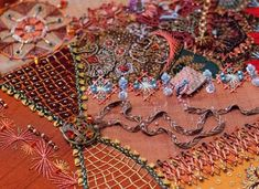 Plays with Needles is the blog of needle artist Susan Elliott.  Susan specializes in surface embroidery, mixed-media, stumpwork, silk threadwork and beading.