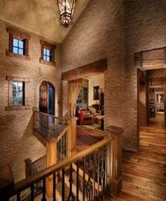 Interior Wood Stair Railing Entry Mediterranean Rustic Wood Floor Celebrity Custom Homes Wall Brick Design Home Ideas Indoor Balcony Wood Flooring Antique Ciling Lamp Ideas Stair Railing Design for Contemporary House Stair
