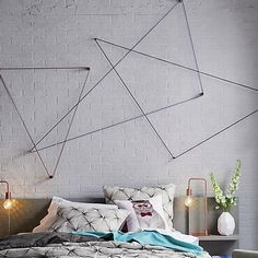DIY Wall Decor: Rope geometric shapes with yarn using our Currency Hooks.