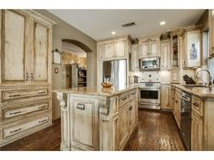 Antiqued kitchen with a country feel // Granite and stainless