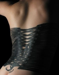 Corset tattoo. I want one on my back, possibly with dermals.