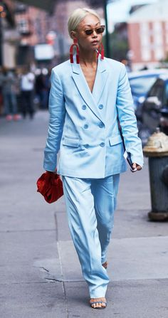 How to wear a trouser suit like the street style set, and our guide to the best suits to buy now.