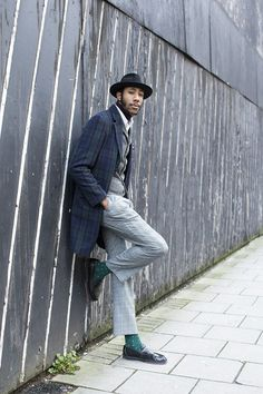 Latouche, apprentice hat maker --- Wearing a Debenhams Hammond and Co overcoat, River Island waistcoat, Ben Sherman polo neck, Lacoste shirt, his Dad's pocket square, Debenhams trousers, Topman socks and Anthony Miles shoes.