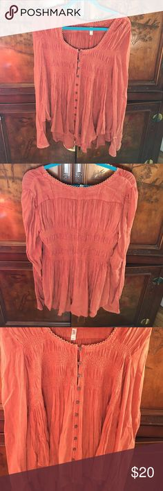 Free People Long sleeve top Long sleeve top. Buttons all the way down. Super cute and stylish. Worn once. BELL SLEEVED Free People Tops Tees - Long Sleeve