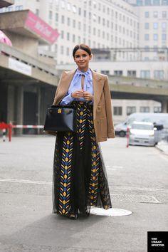 Miroslava Duma in neutral jacket over Valentino pussy-bow shirt & tribal net-mesh skirt | fashion week street style