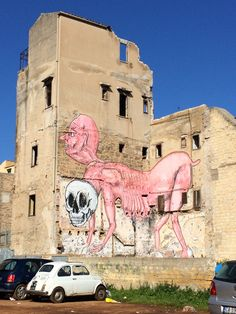 #Graffiti in the middle of La Khalsa, #Palermo, #Sicily. Weird #man and #animal at the same time with a #skull as a toy between his legs. Completed by the Fiat 500 in the front.