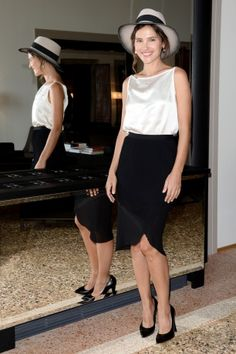 Virginie Ledoyen wore a Chanel top, skirt, and shoes with a Maison Michel hat.
