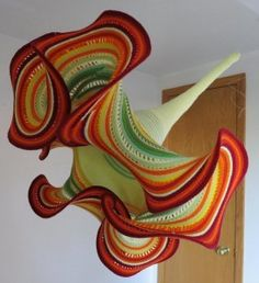 Hyperbolic surfaces in crochet (Yellow Trumpet by Gabriele Meyer).