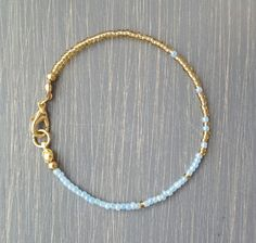 Pastel blue & gold lined seed beads finished with gold plate lobster clasp & ring. The perfect bracelet for those who prefer simple & delicate jewelry that can be worn any day. Pick a size or add a ch