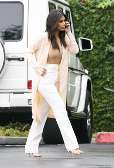 Kim Kardashian - Cream Coloured Cardigan, Beige Top & Loose-Fit Pants