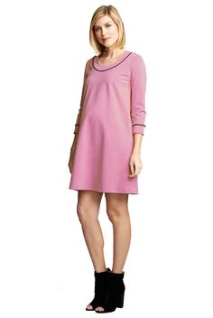 1cc10e2e57a Blush pink shift maternity dress with an easy fit trimmed in black piping.