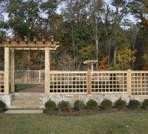 Cedar Fence and Arbor Atop Stone Wall - New Vernon, NJ