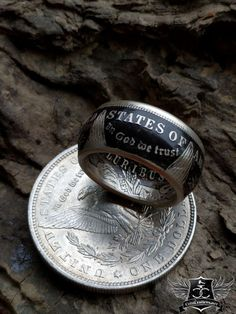 This coin ring features a Morgan Silver Dollar expertly crafted and customized to your personality. With your choice of finishes, either a