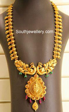 Image from http://4.bp.blogspot.com/-c-kMYTa-rlE/U598nFQfJmI/AAAAAAAAMjg/4Sr3vwvzOcY/s1600/mango_necklace_peacock_pendant.jpg.