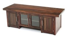 This modern entertainment center is handcrafted from solid exotic rosewood. It features a contemporary linear design with stainless steel pulls. It is available in custom size and layouts.