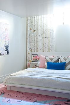White bedroom with pink, gold, & blue accents