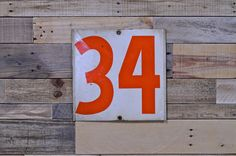 VINTAGE GAS STATION NUMBERS34/22, CHANGEABLE METAL GAS STATION NUMBERS  Double sided sign, number 34 on one side and 22 on the other. Deep orange