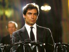 """Timothy Dalton is so extravagantly beautiful he's breathtaking – a lean, athletic 6'2″, dark hair, perfectly chiseled features, mellifluous voice, classically trained. He's equal parts ultimate alpha male and refined English gentleman (even though he is Welsh by birth): incredibly elegant but maddeningly dangerous. He's like a sinuous emerald eyed jungle cat poised to pounce."""