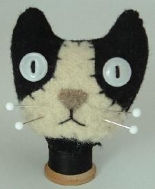 great pincushions, make do's, & ornies at this page.....LOVE the cats
