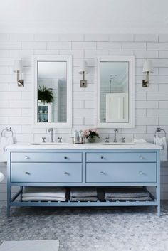 Gorgeous light blue and white bathroom remodel makeover with blue cabinets and white subway tiles with matching sconces and double his and hers sinks. So fresh and modern but classic and traditional at the same time! Blue Bathroom Vanity, Blue Vanity, Master Bathroom, Vanity Mirrors, Boho Bathroom, Bathroom Vanities, White Bathroom, Sinks, Bathroom Styling