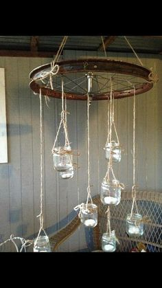 Porch chandelier from baby food jars and a bicycle wheel!