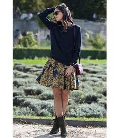 You know it's fall when the chunky knit sweaters emerge to join otherwise summery skirts and dress.   - MarieClaire.com