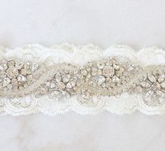 Crystals on lace garter