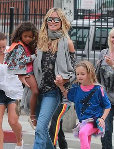 Heidi Klumwearing a pair of flare Textile Elizabeth and James Jeans.