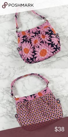"""Loves Me..."" Vera Bradley Reversible Tote NWOT Vera Bradley tote in Loves Me... pink daisy pattern. Magnetic closure. Two pockets on the inside and outside. Vera Bradley Bags Totes"