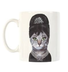 audrey hepburn cat mug    Reminds me of April's cat, Juliet, we dressed her up in pearls, a crown and a boa once......she was eating out of a champagne glass......and she loved every minute of it!  Juliet continued to wear the pearls around April's apartment afterwards.....like it was meant to be.