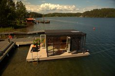 Floating Houses // Modern Kenjo Cabin is a solar-powered floating room for a family in Sweden