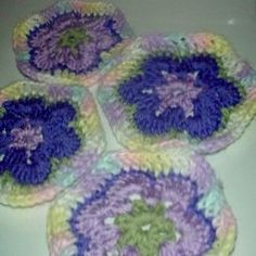 "Tired of the same old granny squares? Even the beginner can whip up these pretty flower hexagons. I'll show you how step by step below.    When you are finished crocheting your African Flower Hexagons, you can sew them together into a baby blanket, afghan, unique tote, scarf, or anything else you can imagine. For more information on joining crochet, visit ""How to Join Granny Squares.""    You will need:  *Crochet hook - size F, G, or H  *Worsted weight yarn of various colors"
