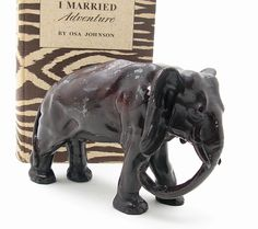 "1920's Cast Iron Elephant      Handsome c. 1920's cast iron elephant. Measures 8-1/2"" long, 4"" at its widest point and 5-3/4"" tall. Original dark brown paint that has worn in places. Quite heavy at nearly 4 pounds. $ 265 4/2/12"