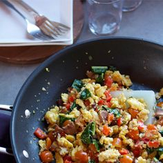 Breakfast Scramble with eggs, sausage, kale, goat cheese, cherry toms