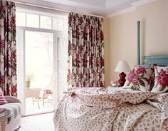 Here's fabric-driven decor at its splashiest — an entire master bedroom worked around Carleton V's exuberant floral print, Rhododendron. The reversible quilt is Carleton V's Rossway in two colorways, soft red and green. The painted green Lisle headboard in pistachio is from Ficks Reed. The soft yellow walls are Pale Hound by Farrow  Ball. Alexis lamp in cardinal from Pottery Barn.