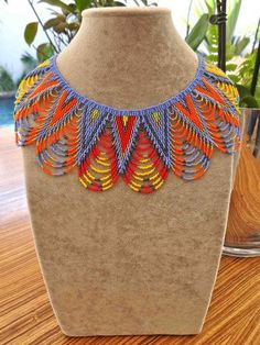 The Susie Necklace 2. These unique hand beaded crochet necklaces are made by a team of ladies living in a rural area of Kwa Zulu Natal. Each lady is the sole breadwinner in her family. They take traditional Zulu beadwork to new levels by combining traditional skill with contemporary designs often including vibrant colours