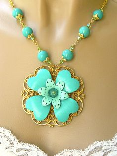 Imagine yourself wearing this stunningly pretty turquoise colored flower pendant necklace.  The handmade beaded necklace has turquoise colored howlite beads, Swarovski Austrian crystals, metal...@ artfire