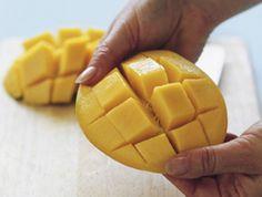 Cutting a mango hedgehog style